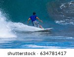 riding the waves. costa rica ... | Shutterstock . vector #634781417