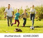cheerful family of four people... | Shutterstock . vector #634813085