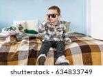 portrait of small boy in black... | Shutterstock . vector #634833749