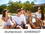 group of young people having... | Shutterstock . vector #634834637