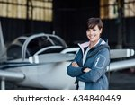 smiling young woman posing with ... | Shutterstock . vector #634840469