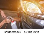 cleaner washing the car window... | Shutterstock . vector #634856045