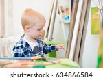 a child draws a picture paints... | Shutterstock . vector #634866584