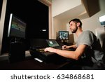 a lighting engineer works with... | Shutterstock . vector #634868681