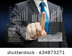 businessman hand touching the... | Shutterstock . vector #634873271