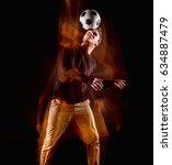 a portrait of a fan with ball... | Shutterstock . vector #634887479