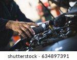 close up hands of... | Shutterstock . vector #634897391