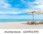 beach chair with umbrella with... | Shutterstock . vector #634901495