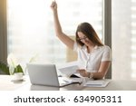 happy businesswoman with raised ... | Shutterstock . vector #634905311