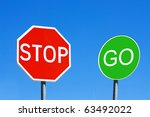 stop and go sign against a blue ...