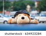 dog stuffed animal on car roof | Shutterstock . vector #634923284