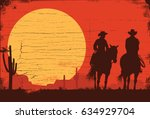 silhouette of cowboy couple... | Shutterstock .eps vector #634929704