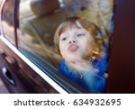 baby boy in the car. | Shutterstock . vector #634932695
