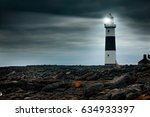 Lighthouse At Night With...