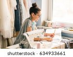 close up. hands woman tailor... | Shutterstock . vector #634933661