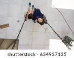 little girl flying on swing in... | Shutterstock . vector #634937135
