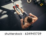 athletic shirtless male doing... | Shutterstock . vector #634945739