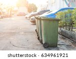Old Green Plastic Garbage Bin
