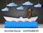 young bearded man in paper ship ... | Shutterstock . vector #634968839