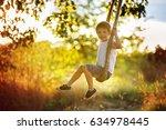 cute child  boy  having fun on... | Shutterstock . vector #634978445