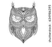 black outline owl silhouette... | Shutterstock .eps vector #634986395