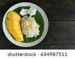 top view ripe yellow mango and...   Shutterstock . vector #634987511