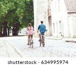 happy traveling couple riding... | Shutterstock . vector #634995974