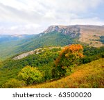Mountain landscape in nice autumn day - stock photo