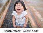 crying little girl on street... | Shutterstock . vector #635016539