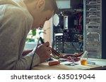 man repairman is trying to fix... | Shutterstock . vector #635019044