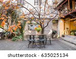 table to eat under the tree in... | Shutterstock . vector #635025134
