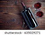 bottle and two glasses of red... | Shutterstock . vector #635029271