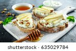 appetizer bruschetta with pear  ... | Shutterstock . vector #635029784