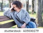 sad black woman seated alone on ... | Shutterstock . vector #635030279