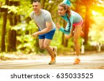 runners sports in autumn park....   Shutterstock . vector #635033525