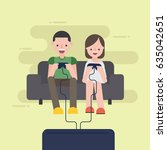 couple playing video games | Shutterstock .eps vector #635042651