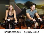 two people biking in the gym ... | Shutterstock . vector #635078315