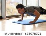 attractive man doing pushups in ... | Shutterstock . vector #635078321