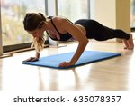 young beautiful woman doing... | Shutterstock . vector #635078357