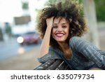 young mixed woman with afro... | Shutterstock . vector #635079734