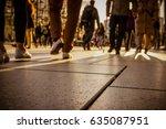 people walking center street... | Shutterstock . vector #635087951