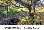 small bridge in the english... | Shutterstock . vector #635095619