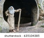 bearded hermit in a cave stands ... | Shutterstock . vector #635104385