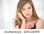 Young Attractive Girl With...