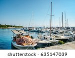view to fishing boats at pier...   Shutterstock . vector #635147039
