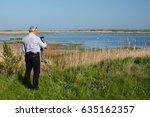 man birdwatcher shoots video of ... | Shutterstock . vector #635162357