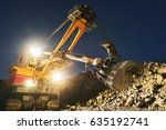 Small photo of Mining construction industry. Excavator digging granite or ore in quarry