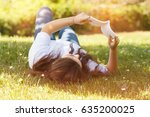 young woman lying down on grass ...   Shutterstock . vector #635200025