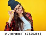 young woman posing over yellow...   Shutterstock . vector #635203565
