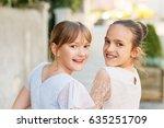 outdoor portrait of two sweet... | Shutterstock . vector #635251709